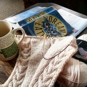 Knitting, drinking coffee and reading. Standard conduct on a Sunday morning.
